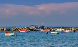 Fishing boats surrounded by rocks Royalty Free Stock Photos