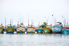 Fishing boats in Tangalle port. TANGALLE, SOUTHERN PROVINCE, SRI LANKA, ASIA - DECEMBER 20, 2014: Colorful wood fishing boats moored on December 20, 2014 in Stock Photo