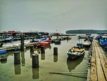 Fishing boats in Teluk Bayu Floating Chalets Area Stock Photo