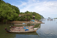 Fishing boats in Thailand. Fishing boats in a small village on the Adaman sea in Thailand Stock Photos