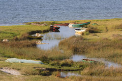 Fishing boats on theUembje Lagoon - Bilene - Mozambique. Bilene, also known as Praia do Bilene, is a town in southern Mozambique. It is known as a beach resort Royalty Free Stock Photography