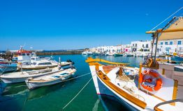 Fishing boats tied up at a dock in Naoussa port, Greece. Fishing boats tied up at a dock in Naoussa port, Paros, Greece. Typical fishing boats and small yachts stock image