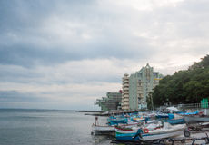 Fishing boats and tourist hotels in Pomorie, Bulgaria Royalty Free Stock Photos