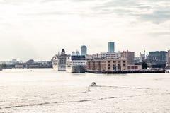 Fishing Boats Toward Cruise Ships at Dusk Stock Photo