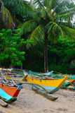 Fishing boats on a tropical beach Royalty Free Stock Photography