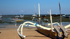 Fishing boats on the tropical beach of Bali island, Indonesia. stock video footage