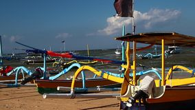 Fishing boats on the tropical beach of Bali island, Indonesia. stock footage