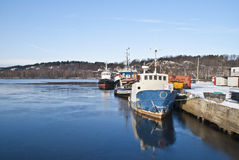 Fishing boats and tugs. (4). Fishing boats and tugboats moored to the docks at the port of Halden Royalty Free Stock Photography
