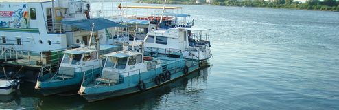 Fishing boats on Tulcea Harbour. Concept BANNER royalty free stock images