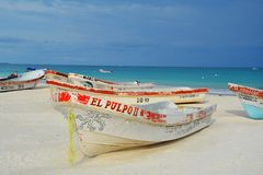 Fishing boats at Tulum beach Stock Images