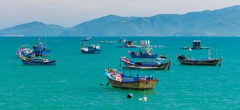 Fishing Boats On A Turquoise Ocean Vietnam Royalty Free Stock Photo