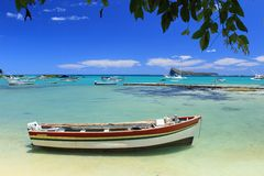 Fishing boats, turquoise sea and tropical blue sky Royalty Free Stock Image
