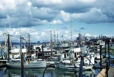 Fishing Boats Vancouver British Columbia Canada. Ominous clouds over fishing boats in Vancouver harbour, British Columbia, Canada royalty free stock photo