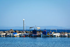 Fishing boats. View of fishing boats in the row in a Greek island Stock Photos