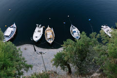 Fishing boats at Voulismeni lake in Agios Nikolaos Royalty Free Stock Images