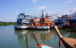 Fishing boats vs. trawlers Stock Photography