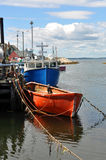 Fishing boats at wharf Stock Photos