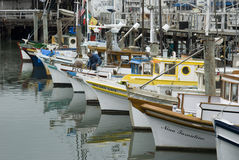 Fishing Boats at Wharf Stock Photo