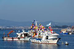 Fishing boats white with flags Royalty Free Stock Photos