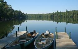 Fishing Boats on Wilderness Lake. Two fishing boats tied to pier on wilderness lake Stock Photo