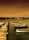 Fishing boats and wooden mole Royalty Free Stock Photography