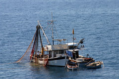 Fishing boats on the work Stock Photography