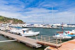 Fishing boats and yachts moored in Italian marina Stock Images
