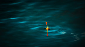 Fishing bobber. Fishing floater at dark water Royalty Free Stock Photography