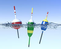Fishing bobbers on water surface Stock Photo