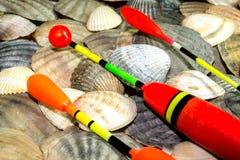 Fishing bobs on the sea shells Stock Photo
