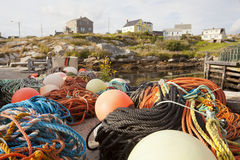 Fishing bouys and nets in fishing villiage Royalty Free Stock Images