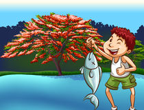 Fishing. Boy in casual clothes caught a fish from the river Stock Images