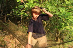 Fishing boy. Little kid - boy prepairing net for fishing Royalty Free Stock Photography