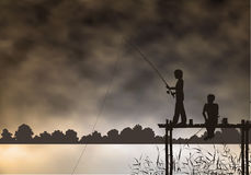 Fishing boys Stock Images