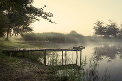 Fishing bridge, morning mist. Over the water royalty free stock photo