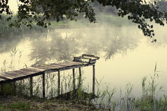Fishing bridge, morning mist. Over the water stock images