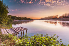 Fishing bridge on a summer morning. Sinrise at lake with fishing bridge Stock Photo