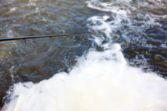 Fishing in bubbling water Stock Images