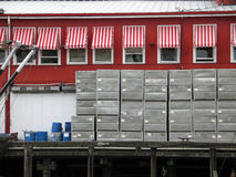 Fishing building with crates Stock Images