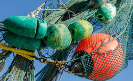 Fishing buoys and nets. Fishing floats, buoys and nets against blue sky stock photography