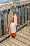 Fishing Buoys on a Pier Stock Photography