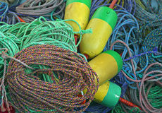 Fishing buoys and ropes. Colorful fishing buoys with many coiled ropes Royalty Free Stock Image