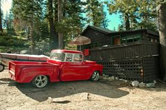 Fishing Cabin. 55 Chevy pickup parked in front of a cabin Royalty Free Stock Photos