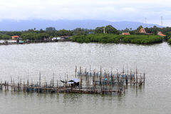 Fishing cage in the the river Stock Images
