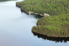 Fishing camp. Plane view of a fishing camp in a wild forest Stock Photo