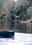 Fishing in a canoe in autumn in maine Stock Photos