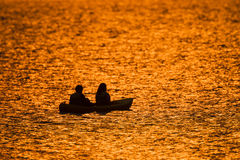 Fishing Teenagers Canoe Dawn Colors Royalty Free Stock Images