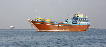 Fishing and cargo ships which are used for transportation in Red Sea and Gulf of Aden Stock Images