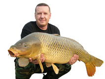 Fishing with carp. Fishing with a large carp isolated on white Royalty Free Stock Photography