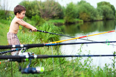 Fishing child. Child fishing in freshwater lake, casting his rod Royalty Free Stock Photography